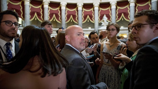Rep. Tom MacArthur, center, pauses while speaking to members of the media off the House Chamber on Capitol Hill in Washington after the Republican health care bill passed in the House in May. (AP Photo/Andrew Harnik)