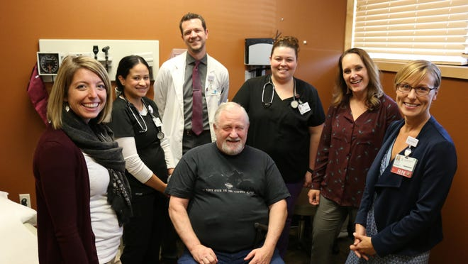 Bob Matlock, a Salem Health patient with diabetes (center), is seen with his care team, certified diabetes educator Jessi Peterson (from left), medical assistant Anilu Cerda, clinical pharmacist AJ Sowles, medical assistant April Dawes, medical director of family medicine Michelle Rasmussen and registered nurse care manager Brandi Libby. Instead of one doctor, under Salem Health's new model, a diabetes patient is assigned a team of care providers.
