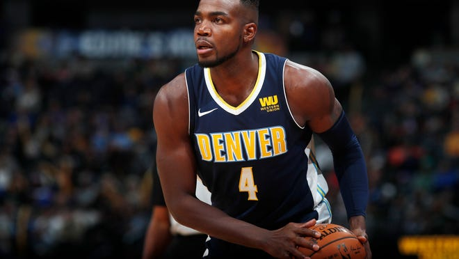 FILE - In this Friday, Nov. 17, 2017, file photo, Denver Nuggets forward Paul Millsap (4) looks for an outlet in the second half of an NBA basketball game in Denver. The Nuggets say All-Star forward Paul Millsap is exploring options to repair a torn ligament in his left wrist, that could sideline the 32-year-old for up to three months. Millsap got hurt in the second quarter of the Nuggets' 127-109 loss to the Los Angeles Lakers on Sunday, Nov. 19. (AP Photo/David Zalubowski, File)