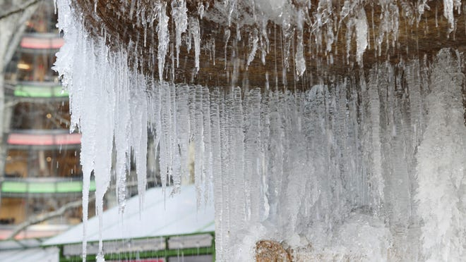 Ice forms on the water fountain at Bryant Park Thursday, Dec. 28, 2017, in New York. (AP Photo/Frank Franklin II)