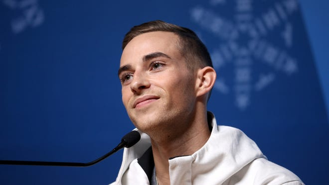 United States figure skater Adam Rippon speaks during a press conference.