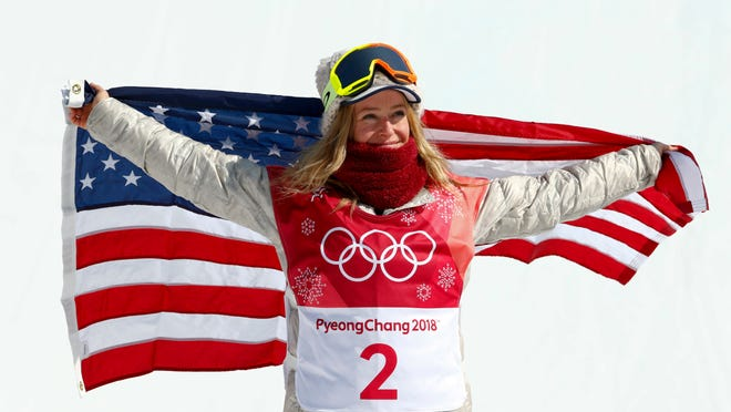 Jamie Anderson, of the United States, celebrates after winning the silver medal in the women's Big Air snowboard final at the 2018 Winter Olympics in Pyeongchang, South Korea, Thursday, Feb. 22, 2018. (AP Photo/Matthias Schrader)