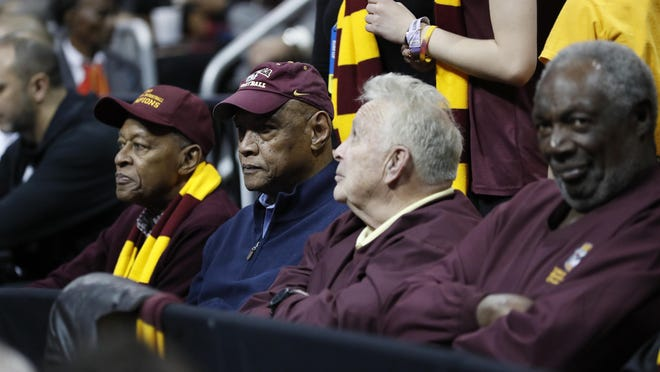 Loyola-Chicago team members from 1963, Jerry Harkness, from left, Les Hunter, John Egan and Rich Rochelle watch action during the 2018 regional semifinal between Loyola-Chicago and Nevada in Atlanta.
