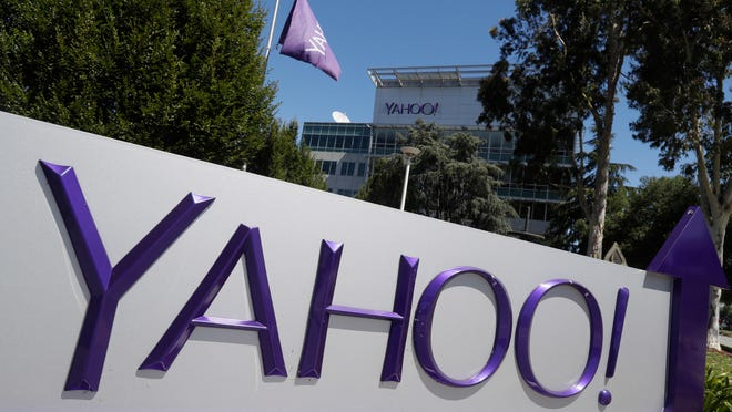This Tuesday, July 19, 2016, photo shows a Yahoo sign at the company's headquarters in Sunnyvale, Calif. On Tuesday, Oct. 3, 2017, Yahoo tripled down on what was already the largest data breach in history, saying it affected all 3 billion of its users, not the 1 billion it revealed in late 2016. (AP Photo/Marcio Jose Sanchez) ORG XMIT: NYBZ206