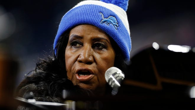 Aretha Franklin rehearses the national anthem during warmups of an NFL football game between the Detroit Lions and the Minnesota Vikings, Thursday, Nov. 24, 2016 in Detroit. (AP Photo/Paul Sancya) ORG XMIT: otkco123