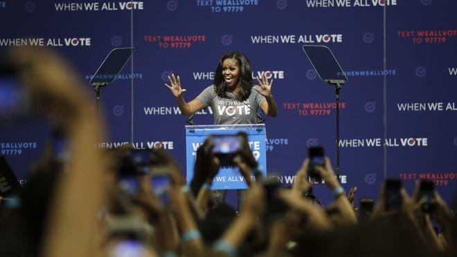 Former first lady Michelle Obama speaks at a rally to encourage voter registration on Friday, Sept. 28, 2018, in Coral Gables Fla.