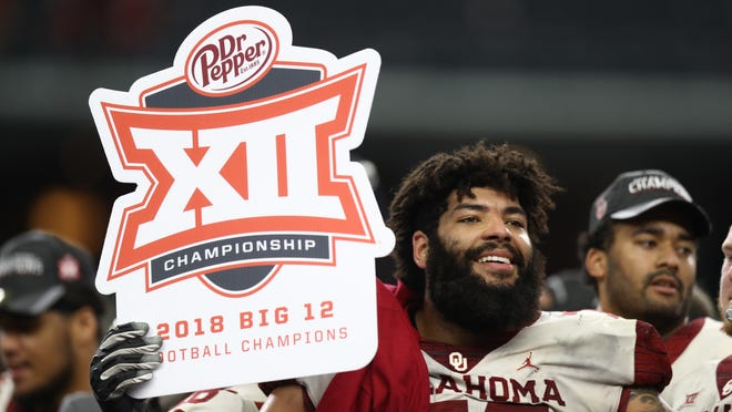 ARLINGTON, TEXAS - DECEMBER 01:  Cody Ford #74 of the Oklahoma Sooners celebrates a 39-27 win against the Texas Longhorns in the Big 12 Championship at AT&T Stadium on December 01, 2018 in Arlington, Texas. (Photo by Ronald Martinez/Getty Images)