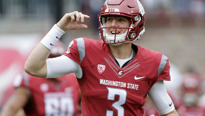 FILE - In this Sept. 17, 2016, file photo, Washington State quarterback Tyler Hilinski (3) runs onto the field with his teammates before an NCAA college football game against Idaho, in Pullman, Wash. Members of the Washington State community were urged to light a candle and hold a moment of silence in memory of quarterback Tyler Hilinski on Wednesday, Jan. 16, 2019, the one-year anniversary of his death. (AP Photo/Young Kwak, File)