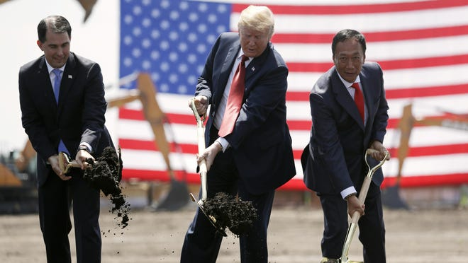 In this June 28, 2018, file photo, President Donald Trump, center, along with Wisconsin Gov. Scott Walker, left, and Foxconn Chairman Terry Gou participate in a groundbreaking event for the new Foxconn facility in Mt. Pleasant, Wis.