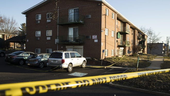 Crime scene tape surrounds the Robert Morris Apartments in Morrisville, Pa., Feb. 26, 2019. A woman and her teenage daughter are facing homicide charges in the deaths of five relatives, including three children, inside an apartment at the complex in suburban Philadelphia, according to authorities.