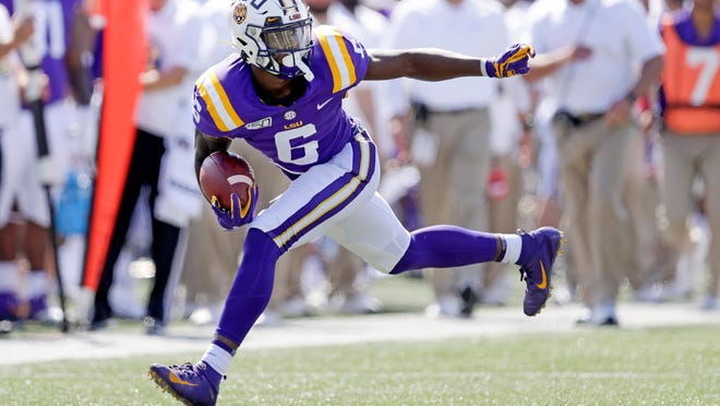 LSU wide receiver Terrace Marshall Jr. carries the ball against Vanderbilt in the first half of an NCAA college football game Saturday, Sept. 21, 2019, in Nashville, Tenn. (AP Photo/Mark Humphrey)