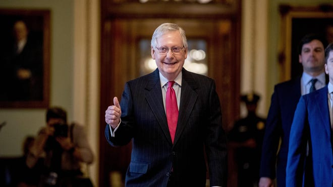 Senate Majority Leader Mitch McConnell of Ky. gives a thumbs up as he leaves the Senate chamber on Capitol Hill in Washington, Wednesday, March 25, 2020.