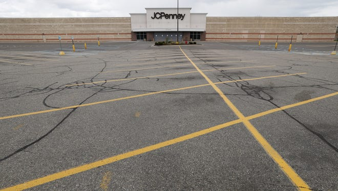 An empty parking lot is shown at a closed JCPenney store in Roseville, Mich., Friday, May 8, 2020.