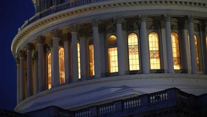 Light shines from inside the U.S. Capitol dome in Washington.