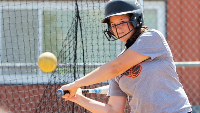 Hallie Mohr a member of the Mediapolis High School softball team takes batting practice before heading to Kalona for a game, Tuesday June 23, 2020 at the school softball field. Mediapolis won their first fame in three years last week, breaking a 61-game losing streak.