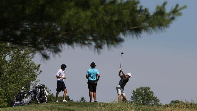 A golfer tees off during the second day of the 2020 Iowa Junior Amateur Championship on June 18 at Spirit Hollow Golf Course.