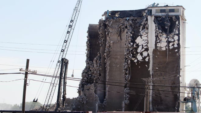 Demolition continues on the former ADM grain elevator Wednesday along the Mississippi riverfront in Burlington. The grain elevator was the site of a massive explosion April 3, 1987 when the 127-year-old wooded elevator attached to the concrete silos exploded. The fire from the explosion burned for five days.