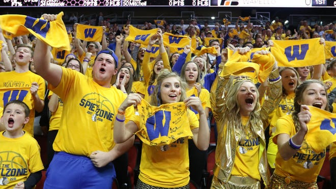 Wapello High School fans cheer the team at the start of their Class 2A state quarterfinal game against Treynor Cardinal March 5, 2018 at the Wells Fargo Arena in Des Moines.