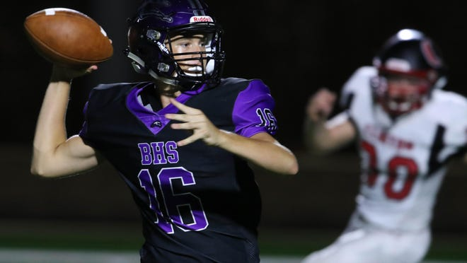 Burlington High School's Brock Dengler (16) looks to pass the ball during the first half of their homecoming game against Clinton High School, Friday Sept. 13, 2019 at Burlington's Bracewell Stadium. The Iowa High School Athletic Association announced changes for the 2020 season, including a seven-week regular season and expanded playoffs.