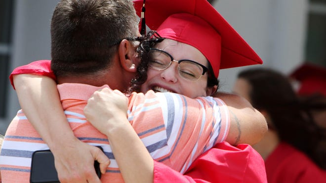 Whitley See hugs her father David McCleary prior to the start of the Southeastern Community College West Burlington campus graduation Saturday at Memorial Auditorium in Burlington.