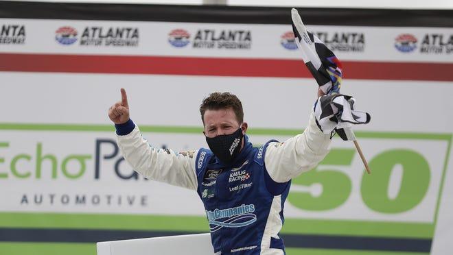 AJ Allmendinger celebrates after winning Saturday night's NASCAR Xfinity Series auto race at Atlanta Motor Speedway.