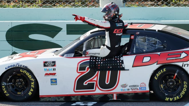 Harrison Burton gets out of his car after winning a NASCAR Xfinity Series auto race Saturday, June 13, 2020, in Homestead, Fla.