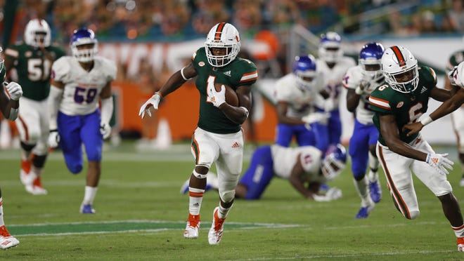 Former Miami running back Lorenzo Lingard runs in for a touchdown during the game against Savannah State on Sept. 8, 2018, in Miami Gardens. Lingard transferred to UF.