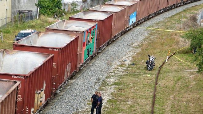 West Palm Beach police investigate the death of a man on the Florida East Coast Railway track near near Conniston Road Tuesday, January 28, 2020.