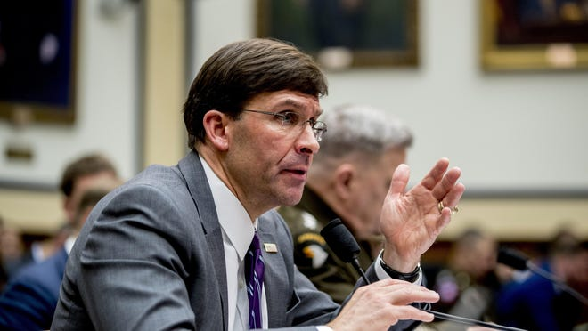 Defense Secretary Mark Esper, left, accompanied by Joint Chiefs of Staff Chairman Gen. Mark Milley, right, speaks at a House Armed Services Committee hearing on Capitol Hill, Wednesday, Feb. 26, 2020, in Washington.