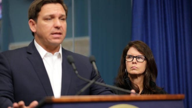 Secretary of the Florida Agency for Health Care Administration Mary Mayhew listens as Gov. Ron DeSantis speaks during a press conference regarding COVID-19 held at the State Emergency Operations Center in Tallahassee on Sunday.