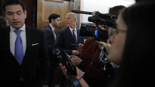 Sen. Rick Scott, R-Fla., (center) and Sen. Marco Rubio, R-Fla., (left) at a coronavirus briefing in March on Capitol Hill.