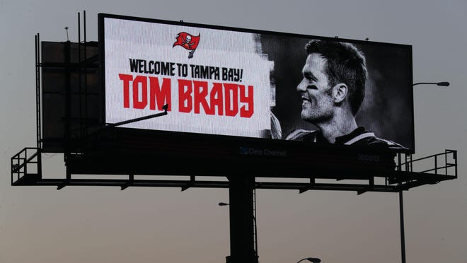 Tampa Bay Buccaneers quarterback Tom Brady is welcomed on a billboard in Tampa.