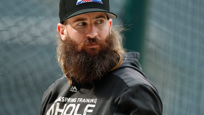 FILE - In this Sept. 11, 2019, file photo, Colorado Rockies right fielder Charlie Blackmon waits to enter the batting cage before the team's baseball game against the St. Louis Cardinals in Denver. All-Star outfielder Charlie Blackmon of the Colorado Rockies has become the first Major League Baseball player known to have tested positive for the coronavirus. A person familiar with Blackmon's situation confirmed the test result to The Associated Press on condition of anonymity because there was no official announcement.