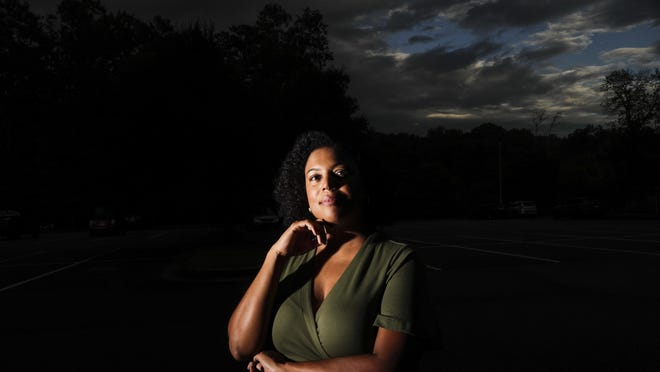 "Charisse Davis poses for a portrait on Friday, July 24, 2020, in Marietta, Ga. Davis was recently elected the only Black woman on the Cobb County School Board. ""We've been watching from the sidelines and allowing other people to take their turns, and take these positions of power,"" Davis said. ""Now here we are to essentially fix it."""