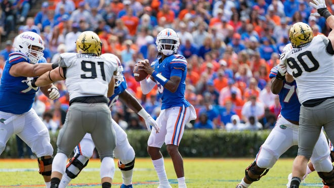 Florida quarterback Emory Jones (5) looks to throw against Vanderbilt last year at Ben Hill Griffin Stadium.