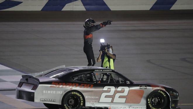 Austin Cindric celebrates winning the NASCAR Xfinity Series Shady Rays 500 on Thursday in Sparta, Ky.