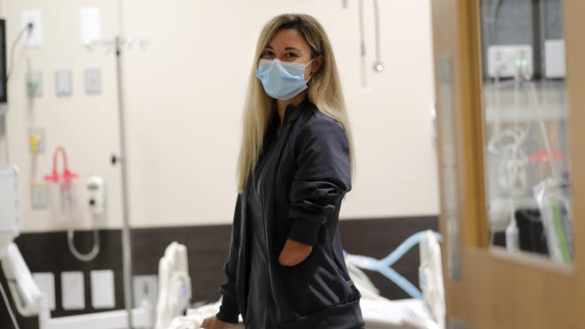Respiratory therapist Savannah Stuard, who was born without a left forearm, poses inside a simulation lab at Ochsner Medical Center in New Orleans.