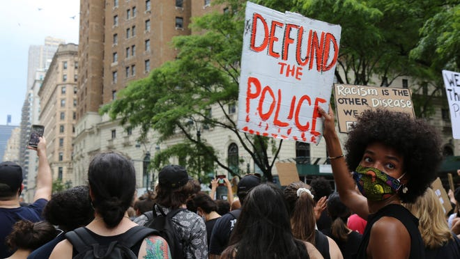 Protesters march Saturday, June 6, 2020, in New York. Demonstrations continue across the United States in protest of racism and police brutality, sparked by the May 25 death of George Floyd in police custody in Minneapolis.
