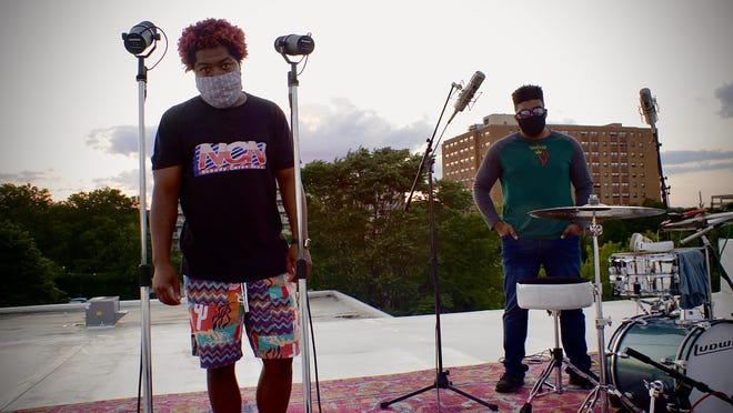 Free Black!, the duo of emcee Floco Torres, left, and drummer-producer HRIII, aka Holbrook Riley III, give a rooftop performance for EarthQuaker Sessions.