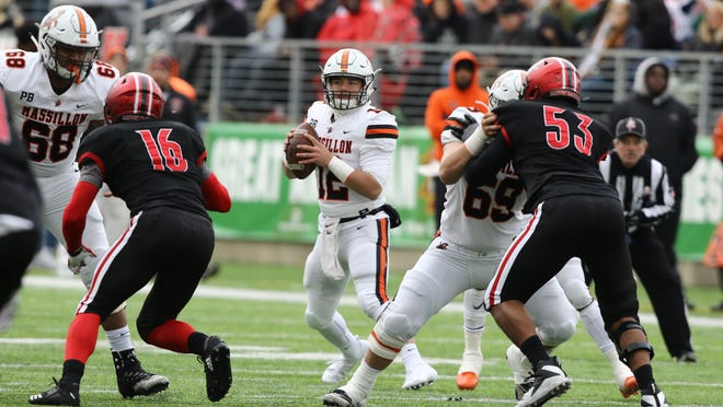 Massillon linemen Terrence Rankl (68) and Dylan Garretson (69) block for quarterback Zach Catrone during the Tigers' win over McKinley last season.