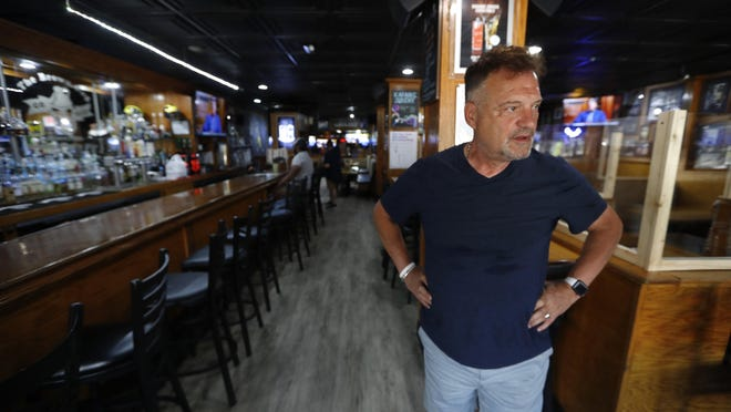 This photo shows Perry Porikos, owner of the The Brown Jug restaurant, in Ann Arbor, Mich. The Greek immigrant arrived here more than four decades ago as a 20-year-old soccer player for the Wolverines and part-time dishwasher at restaurant, which he now owns.