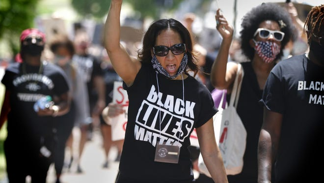 Corinne Collier, a member of Black Lives Matter Rhode Island, marches to the State House in Saturday's Black Women Matter rally.