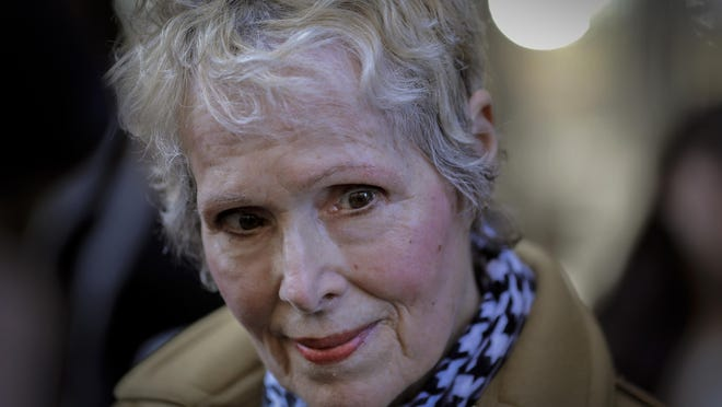 In this photo from March 4, E. Jean Carroll talks to reporters outside a courthouse in New York, where her defamation lawsuit against President Donald Trump was being heard.