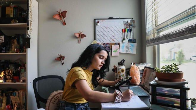 Claudia Wimsatt was supposed to be a first-year psychology student living on campus at Arizona State this year. Instead, she is starting college from her bedroom in Round Rock.