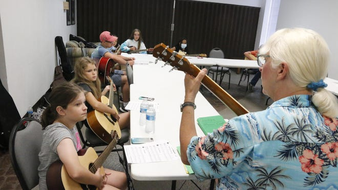 Jackie Andersen teaches a guitar class Wednesday afternoon during the Music Camp, sponsored by Brownwood Music and held this week at the Adams Street Community Center.