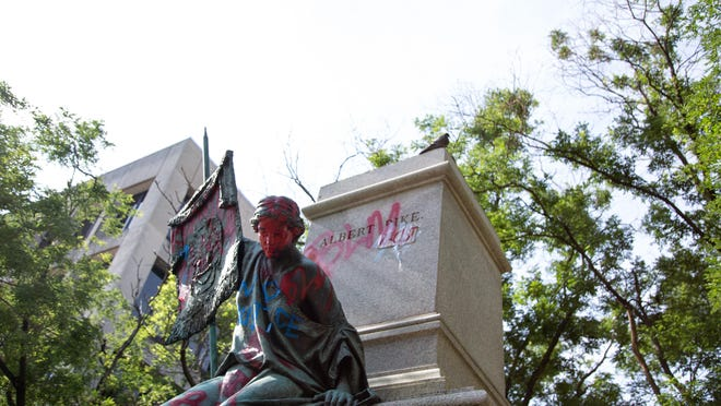 A monument that formerly held a statue of Albert Pike, the Confederate general with ties to Fort Smith and Van Buren, is seen at  Washington Square in Washington D.C., in July after being toppled in a Black Lives Matter demonstration. The Fort Smith School Board will consider on Monday renaming the Albert Pike Elementary School in Fort Smith.