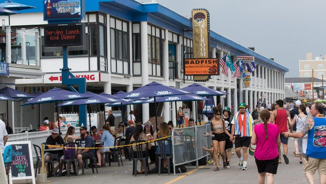 Hampton Beach restaurants are utilizing the sidewalk for open air seating on Ocean Blvd. at  Hampton Beach.