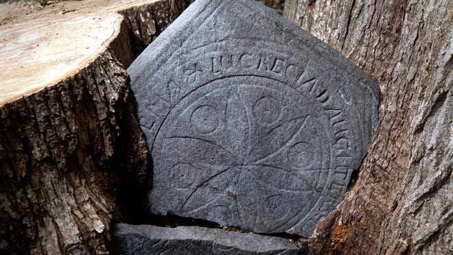 The ornate headstone made in 1736 to memorialize two young girls in Norwich, Connecticut. It was made by Obadiah Wheeler, an influential stone carver. How it came to rest in the crotch of a double tree in Hopkinton isn't clear.