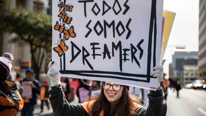 Brenda Godoy holds a banner that read Todos Somos Dreamers (We all are Dreamers) during an Austin rally in 2019. On Thursday, the U.S. Supreme Court ruled in favor of the Deferred Action for Childhood Arrivals, or DACA, program, allowing it to continue despite attempts by the Trump administration to dismantle it.