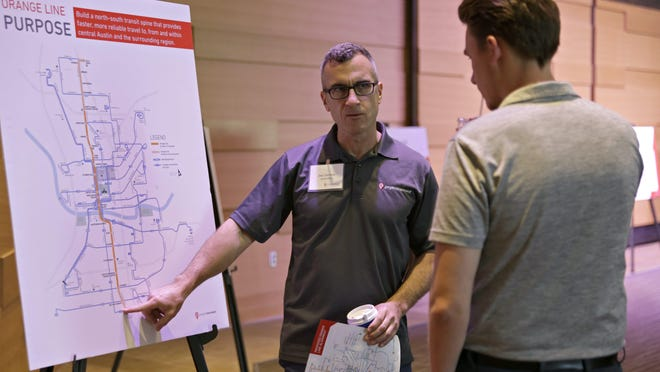 Joe Clemens explains to Lars Anderson the proposed route changes by Capital Metro for their Project Connect plan at the Austin Central Public Library earlier this year. Cap Metro's board and the Austin City Council approved resolutions moving the $7.1 billion project closer to an election.